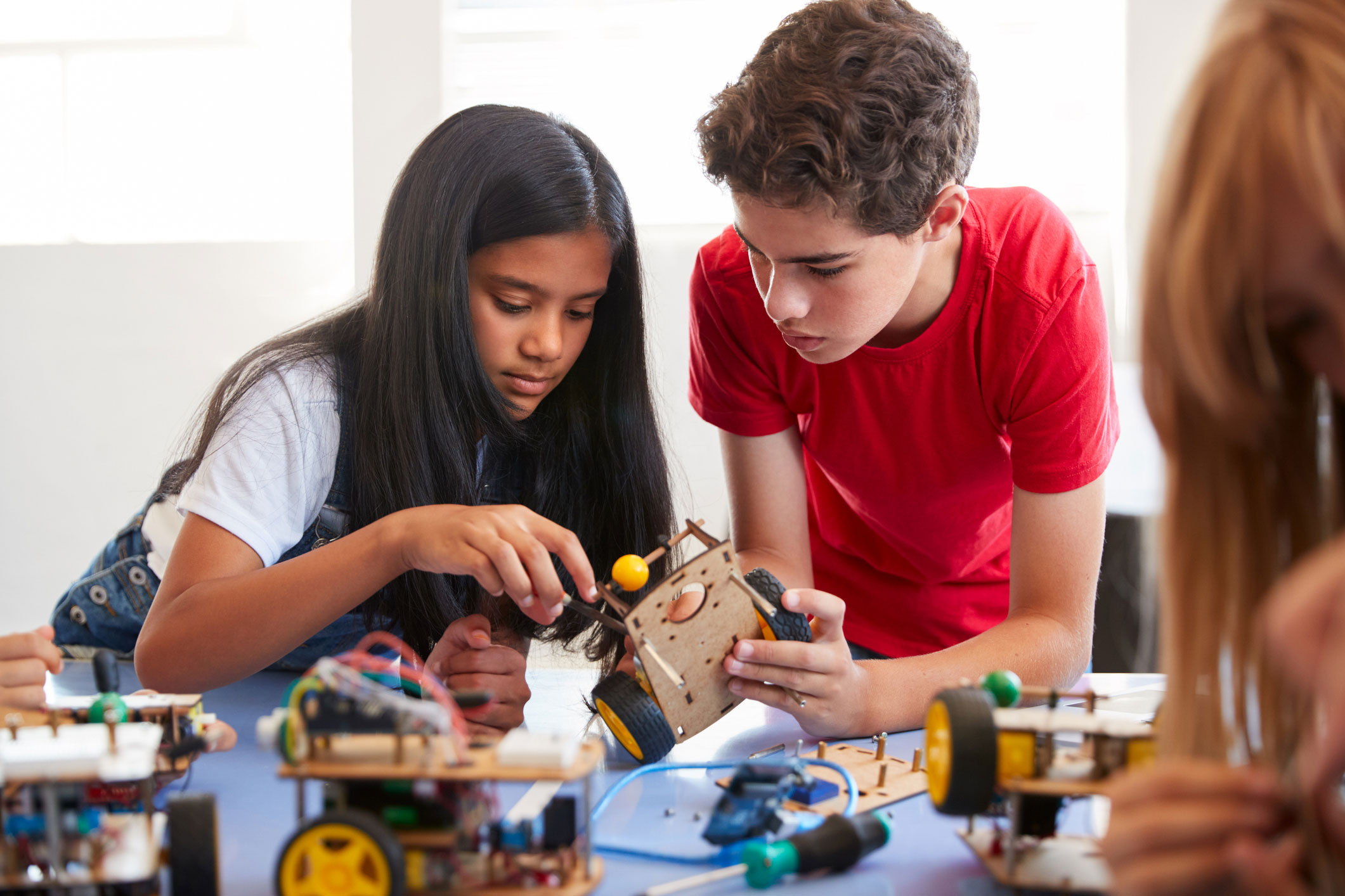 two students working with robotis