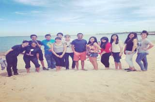 PODER students at beach