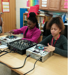 X-STEAM Students working with DJ equipment