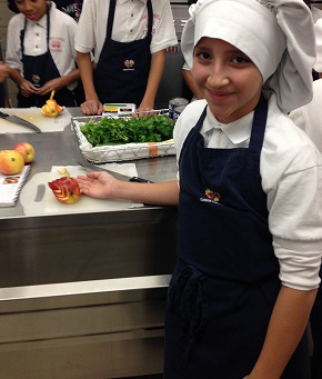 Student with chef hat and food