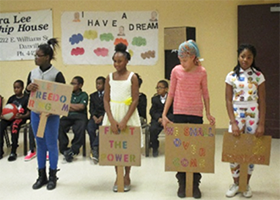 students acting as protestors in Black history month performance
